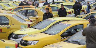Regulamentul pentru taxi propus de PMB: Masini dotate obligatoriu cu POS, statii si aparate de taxat